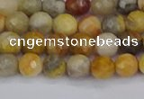 CAG9868 15.5 inches 4mm faceted round yellow crazy lace agate beads