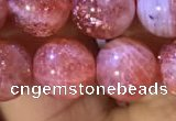 CBQ561 15.5 inches 10mm round golden strawberry quartz beads