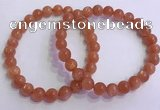 CGB4538 7.5 inches 7mm - 8mm round golden sunstone beaded bracelets