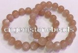 CGB4588 7.5 inches 10mm - 11mm round sunstone beaded bracelets
